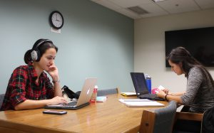 Two students in group study room