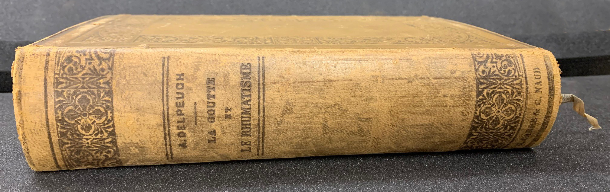 Leather bound book titled La goutte & le rheumatism